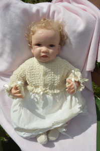 alpaca hand knitted baby cardigan with ribbons sophie